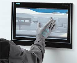 NFI Corp_gloved hand using touch screen_blog